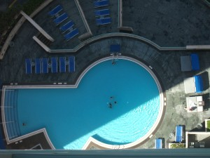 While I worked on Sunday morning in our room on the 29th floor, Jean and Angel went swimming. They're down there in the middle.