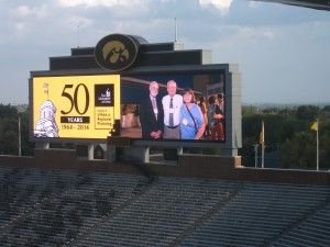 The SURP 50th anniversary dinner took place after the conference at the Kinnick Stadium Press Box. The photographer posted photos from a reception on Friday night at the downtown hotelVetro on the stadium's Jumbotron. It was not my first appearance on a Jumbotron--that was in Fenway Park in April 2011--but that is another story for another time. With m in this image are Professor John Fuller and my wife, Jean.