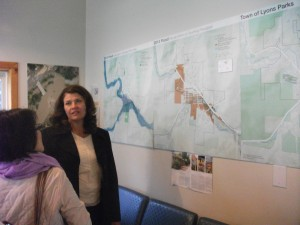 Victoria Simonsen explains the flood maps at the visitor center in downtown Lyons.