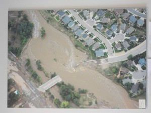 This aerial photo on the wall of the visitor center shows the damage inflicted by the flood on a major local bridge.