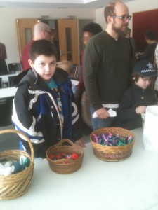 Our grandson, Angel, helps fill zip-lock bags with toiletries for The Night Ministry at Augustana Lutheran Church.