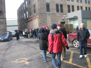 Line forms at the back of the building. It got much longer.