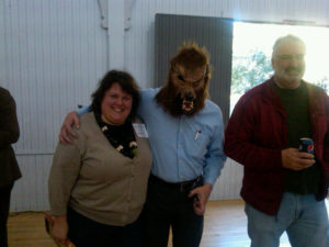Allison Hardin poses with the wolf; David Hart observes (September 2011). Photo by Melissa Ladd.